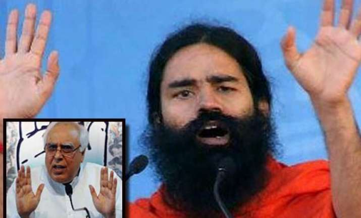 senior ministers persuade ramdev yoga guru to go ahead with