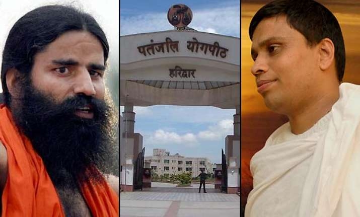 centre unleashes full force of probes against swami ramdev