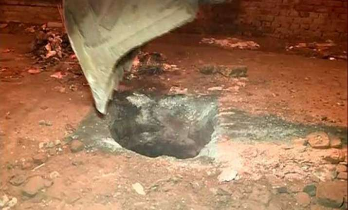 child dies after falling into sewer in delhi