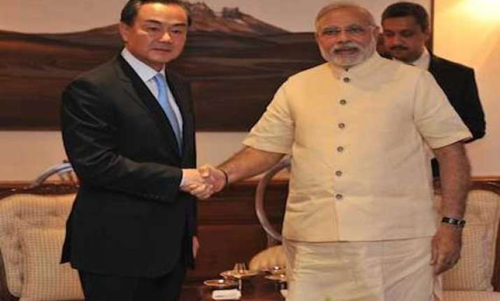 chinese foreign minister wang yi calls on narendra modi