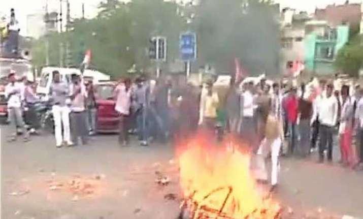 congress protests over power water crisis burns effigies of