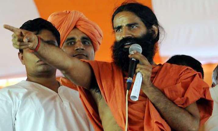 congress is a sinking ship says swami ramdev