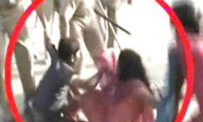 cop beats women protesting children s arrest in aligarh