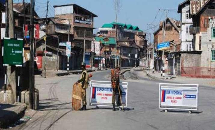 curfew in srinagar after youth s killing