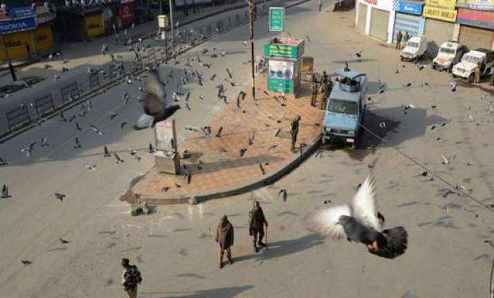 curfew in parts of srinagar city following youth s death