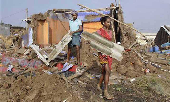 cyclone phailin leaves trail of destruction in odisha s