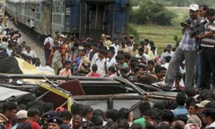 death toll in medak bus train collision climbs to 18