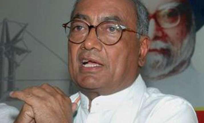 digvijay demands probe into ramdev s activities