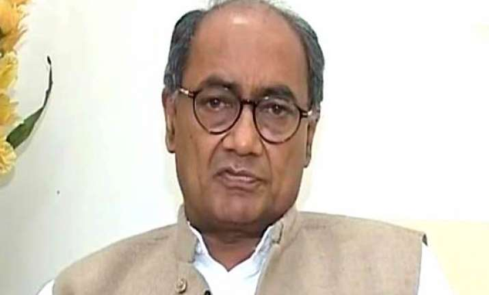 digvijay seeks action against swamy for communal write up