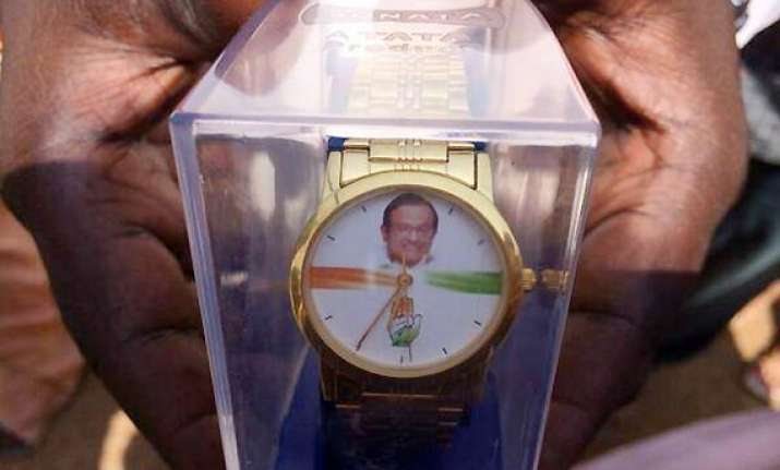 ec seeks report on modi s charge on wrist watches with