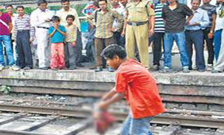 earphones plugged in boy run over by train