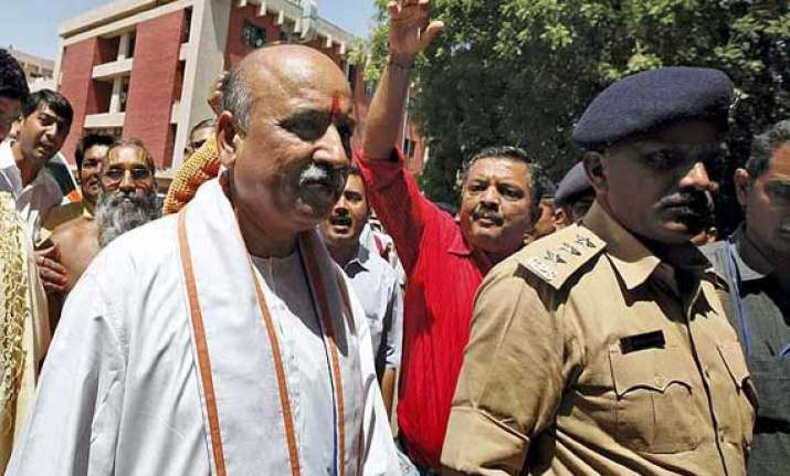 evict muslims from hindu areas togadia spews venom