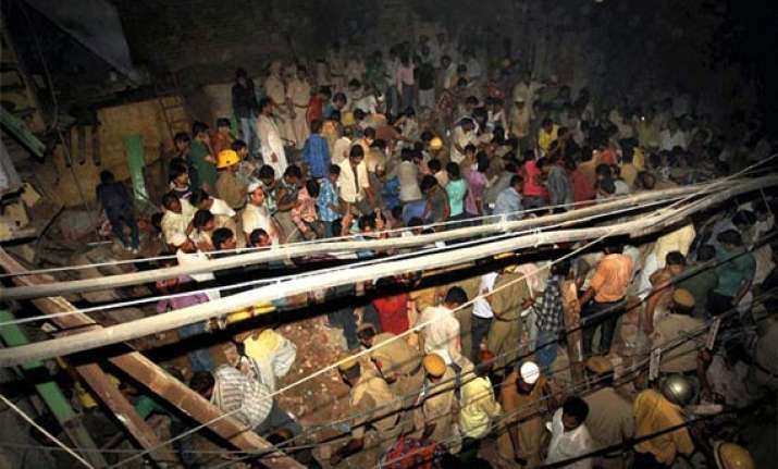 five storeyed 100 year old building collapses in delhi s
