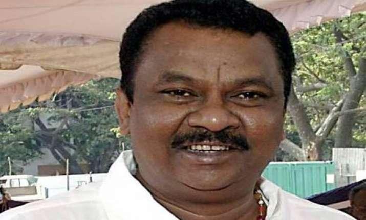 former dmk minister arrested in land grabbing case