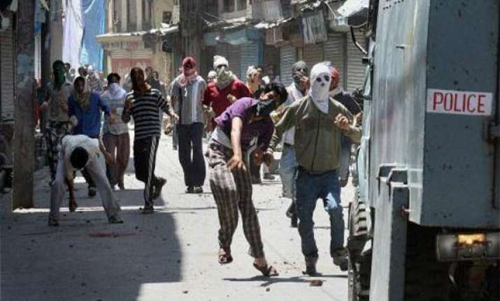 four cops injured in stone pelting by mob in gujarat