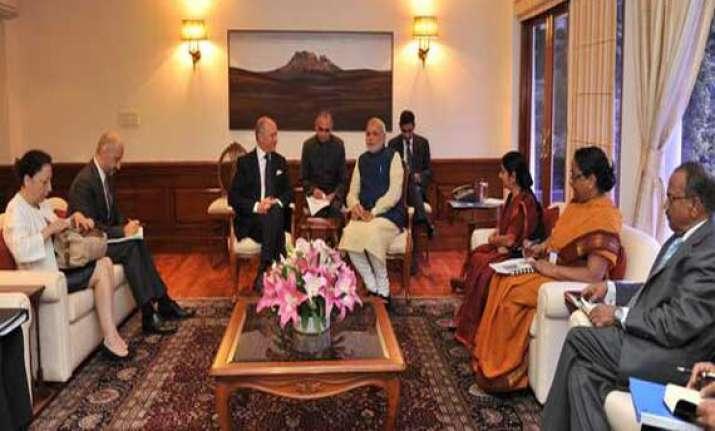 france hails narendra modi s saffron revolution plan for