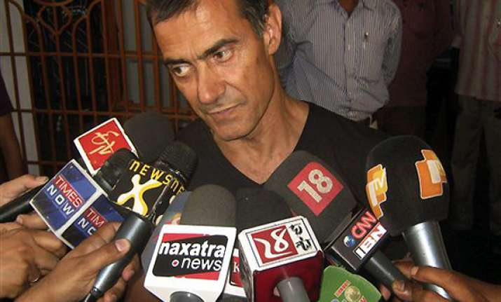 freed italian says they were victims of maoists govt tussle