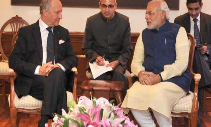 french minister has positive talks with modi invites him to
