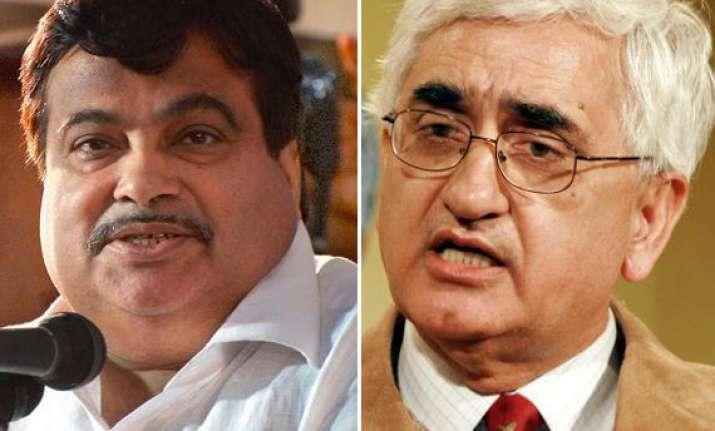 gadkari demands khursheed s expulsion from cabinet