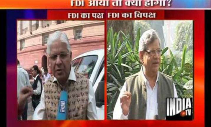 govt to review fdi decision in cabinet oppn demands rollback