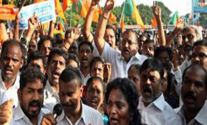 gujarat bjp workers stage protest over weakening indian