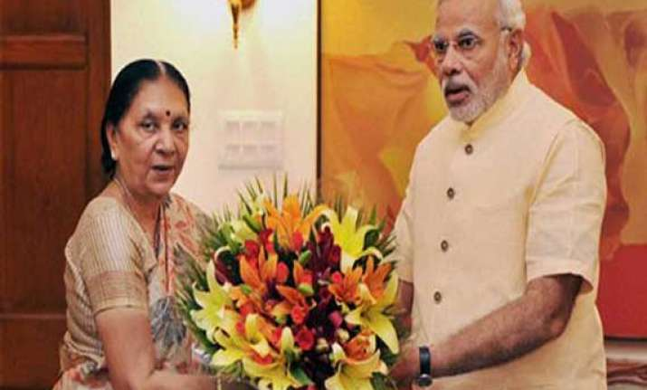 gujarat cm thanks pm for increase in height of narmada dam