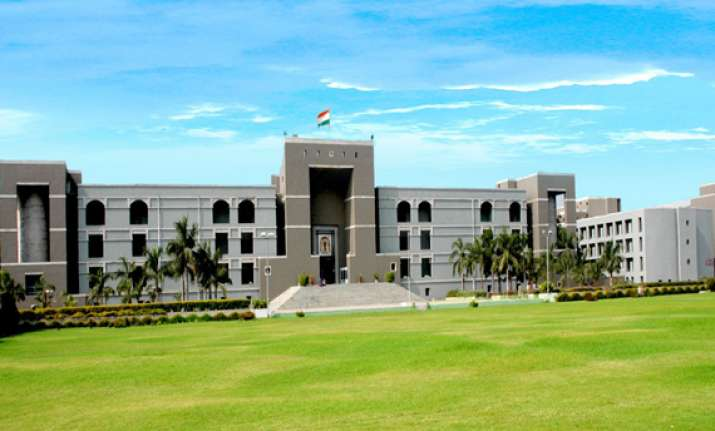 gujarat hc seeks state s reply on land allocation promise