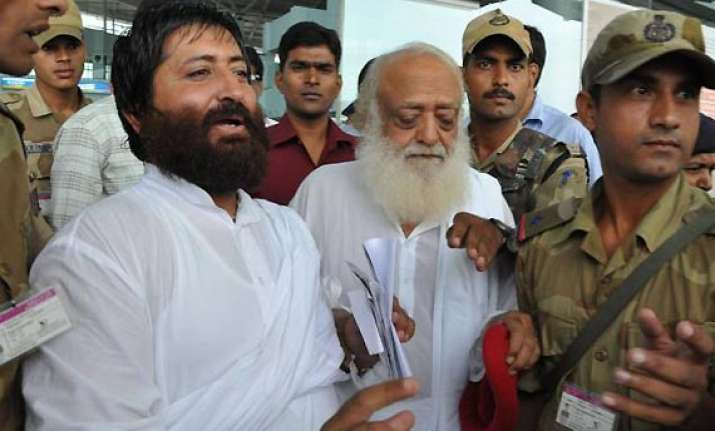 hc reserves order on pleas by asaram his son against firs