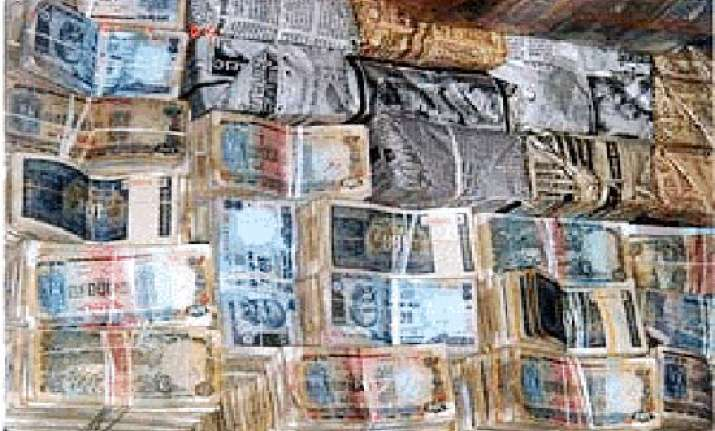 handle your money carefully currency notes swarming with