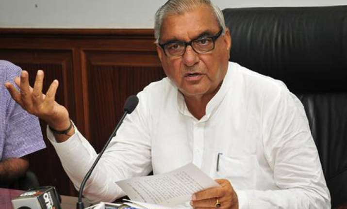haryana cm hooda s relatives friends get prime industrial