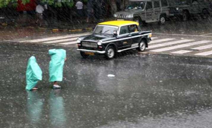 heavy rains cripple life suburban train services in mumbai