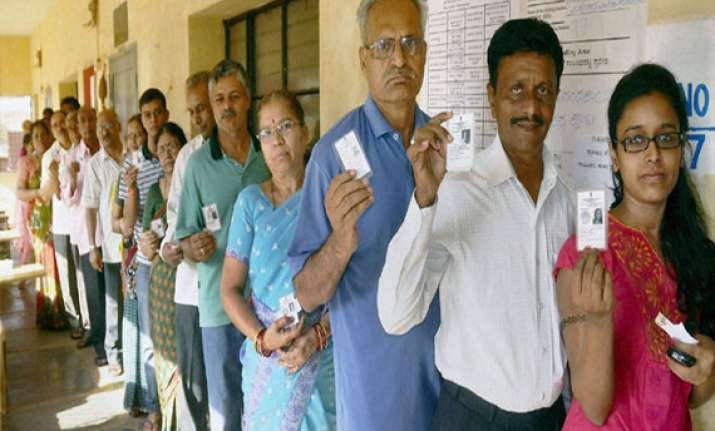 70.23 pc voter turn out estimated in peaceful karnataka