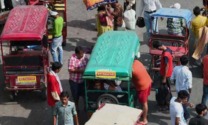 hit by an e rickshaw boy slips out of mother s arm into pan