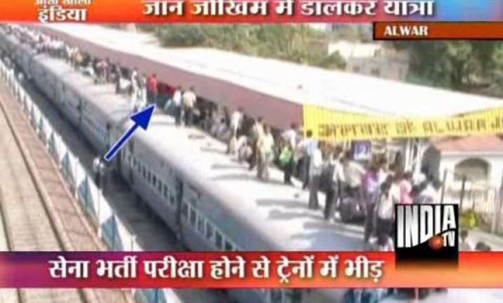 hundreds travel atop trains in rajasthan for army