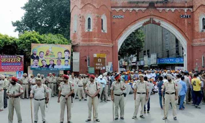 punjab remains on boil paramilitary forces stage flag
