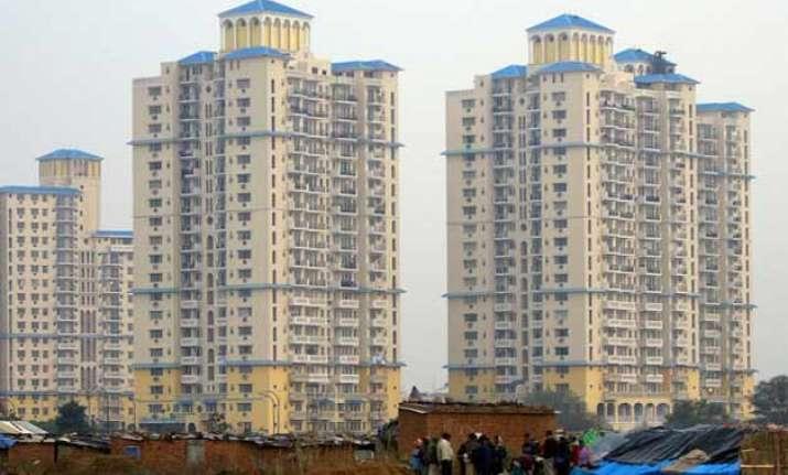 delhi government asks dda mcd to get the flats registered