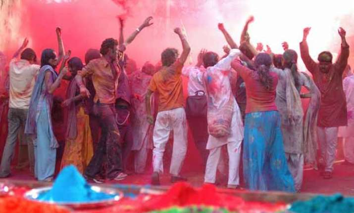 colours rule streets as people celebrate holi