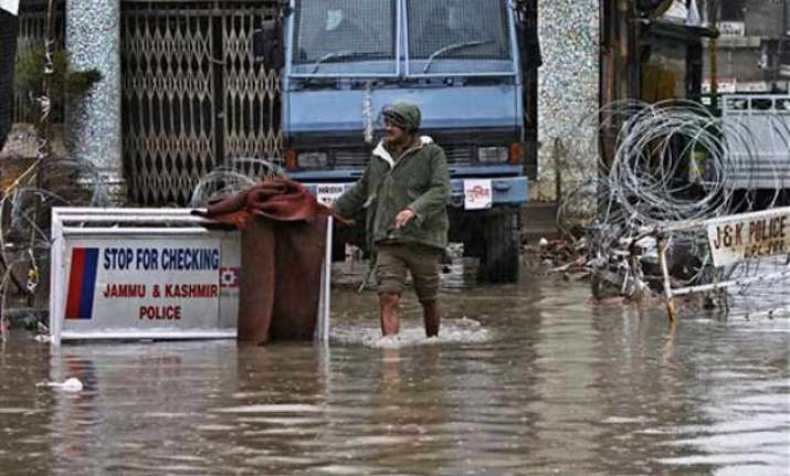 j k floods 17 feared dead rajnath promises all help to cm