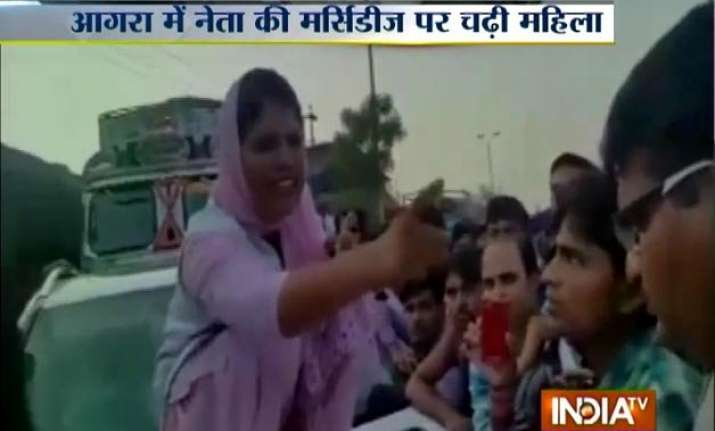 agra woman breaks windshield of sp leader s car after his