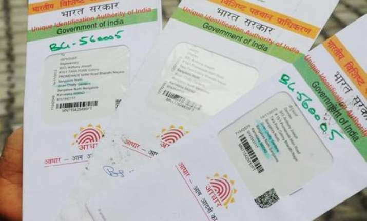 ec to connect voter identity cards with aadhar