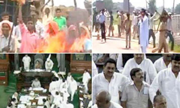 parliament proceedings disrupted over aligarh farmers firing
