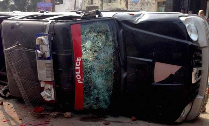 clashes in punjab over desecration of holy book leave 2 dead