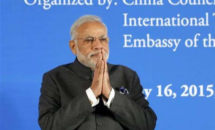 vhp leader slams narendra modi over china trip