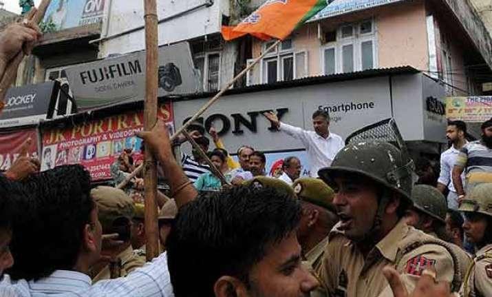 aiims row bjp acc activists clash as jammu observes