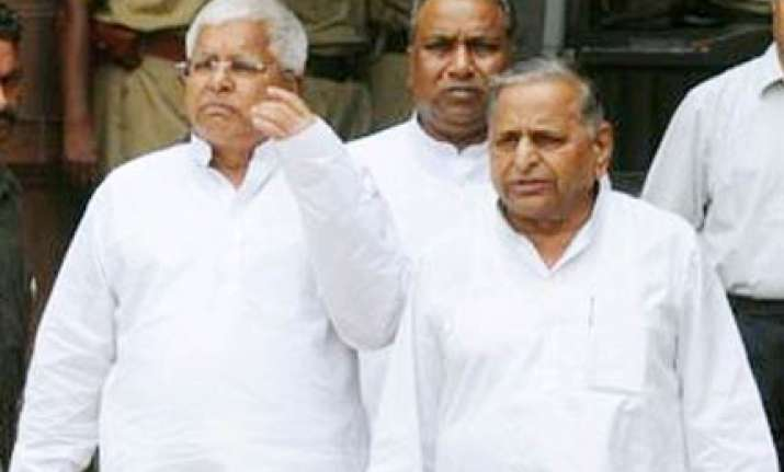 sp rjd announce withdrawal of support to upa govt