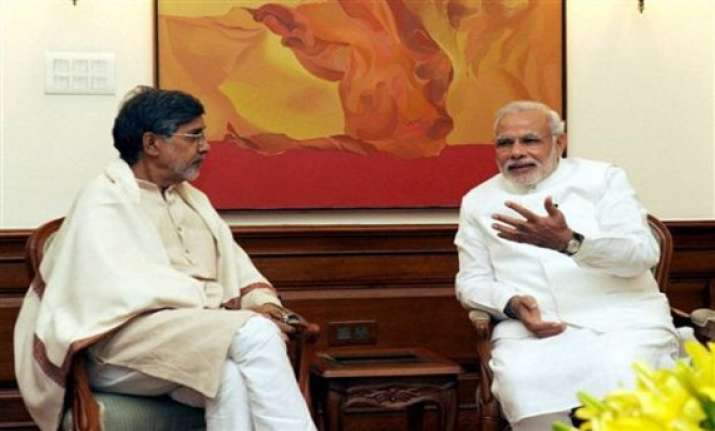 modi felicitates satyarthi who wants to help pm s pet
