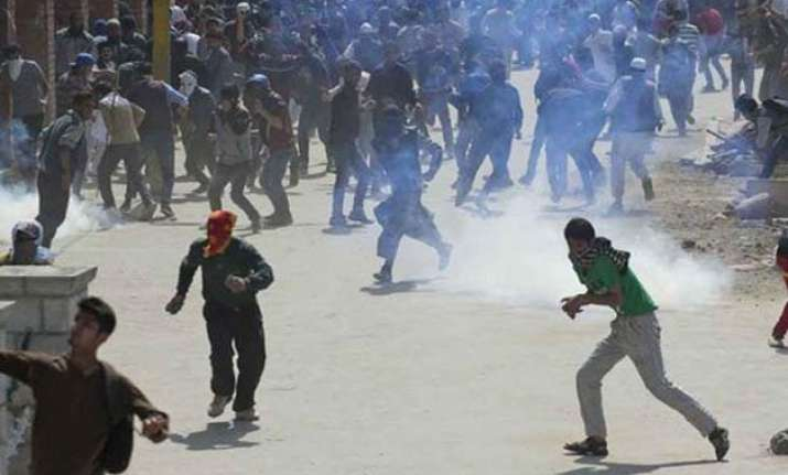 srinagar youth killed in firing by security forces during