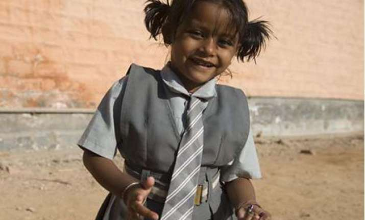 girl born with parasitic twin struggling for survival