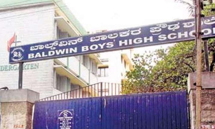 bangalore teacher throws duster boy loses teeth