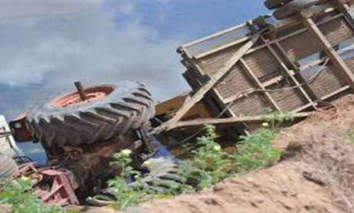 four killed 10 hurt after tractor trolley overturns